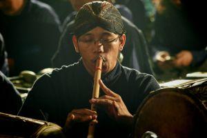 26798110 - javanese flute man playing javanese bamboo flute