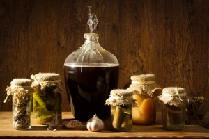 10386929 - homemade wine in larder with vegetables jars