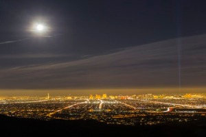 38297616 - las vegas, nevada, usa - february 3, 2015: full moon and early evening haze above the city of las vegas in southern nevada.
